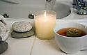 Spa setting with tea candle towel rocks