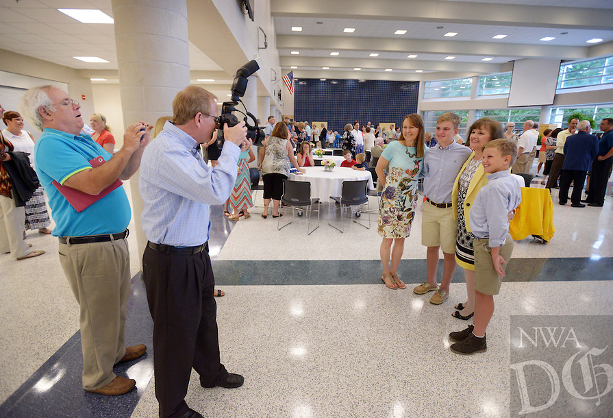 NWA Democrat-Gazette/BEN GOFF @NWABENGOFF<br /> Dr. Janie Darr, superintendent of Rogers Public Schools, greets friends and family on Sunday June 12, 2016 during a retirement celebration for her at Rogers High School. Darr has served various roles in Rogers Public Schools over the past 46 years, including 17 years as superintendent.
