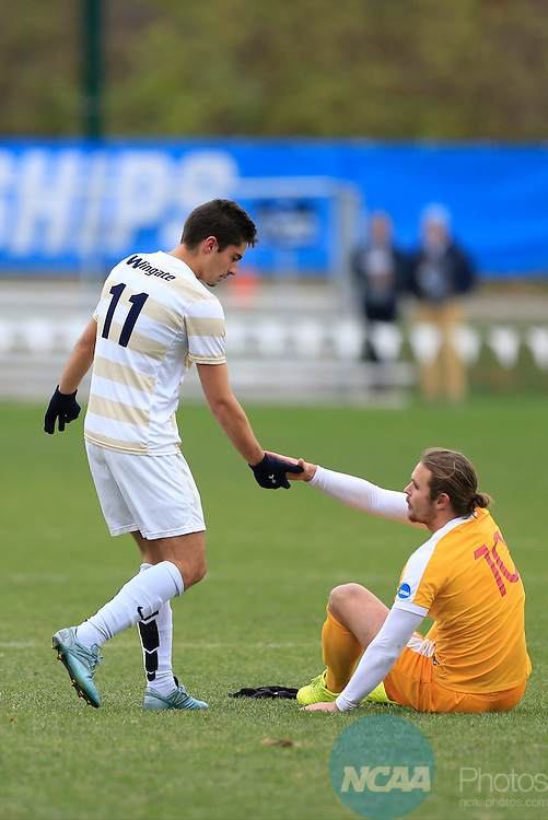 KANSAS CITY, MO - DECEMBER 03:  Patrick Guier (10) of the University of Charleston shakes hands with Jon Ander (11) of Wingate University following the Division II Men's Soccer Championship held at Children's Mercy Victory Field at Swope Soccer Village on December 03, 2016 in Kansas City, Missouri. Wingate beat Charleston 2-0 to win the National Championship. (Photo by Jack Dempsey/NCAA Photos via Getty Images)