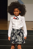 Model walks runway in an outfit by Lili Gaufrette, during the petitePARADE Children's Club fashion show at the Jacob Javits Center in New York City, on January 9, 2016.