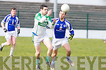Ballydonoghue's Martin O'Mahony and Templenoe's Sean Sheehan in action in the 1st round of the Novice Championship at Ballydonoghue on Saturday.