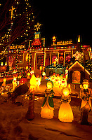 Outdoor lighted Christmas scene in snowy yard of house. St Paul Minnesota USA