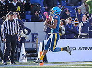 Annapolis, MD - December 28, 2017: Navy Midshipmen running back Malcolm Perry (10) scores a touchdown during the game between Virginia and Navy at  Navy-Marine Corps Memorial Stadium in Annapolis, MD.   (Photo by Elliott Brown/Media Images International)