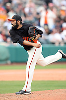 Sergio Romo #54 of the San Francisco Giants pitches against the Arizona Diamondbacks in the first spring training game of the season at Scottsdale Stadium on February 25, 2011  in Scottsdale, Arizona. .Photo by:  Bill Mitchell/Four Seam Images.