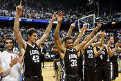 Lehigh players celebrate thier win over the Blue Devils. Lehigh defeated Duke 75-70 during the 2nd round of the 2012 NCAA Basketball Championship at the Greensboro Coliseum in Greensboro, NC. Photo by Al Drago.