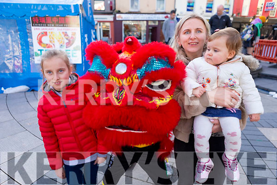 Ingrid, Sofia and Deja Sukyte with the Red Dragon at the Lion & Dragon Ritual for the Chinese New Year celebrations in the square in Tralee on Saturday.
