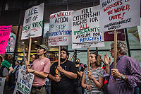 NEW YORK, USA - August 23 : Demonstrators are seen holding signs in a protest to demand Greyhound collaboration with ICE on August 23, 2019 in New York, USA.<br /> Everyday across the U.S., ICE, DHS and Border Patrol agents board buses with Greyhound's permission and attempt to detain migrants. Demonstrators at the Port Authority bus terminal demand Greyhound to end all collaboration with ICE and Border Patrol. <br /> (Photo by Luis Boza/VIEWpress)