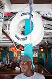 EXUMA, Bahamas. Local man inside the Staniel Cay Yacht Club in Staniel Cay.