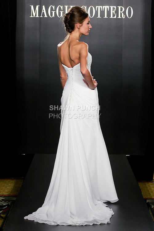 Model walks the runway in an Erin Couture wedding dress from the Maggie Sottero Bridal Spring 2012 collection, during  Couture: New York Bridal Fashion Week 2012