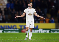 Jordi Amat of Swansea City reacts during the Capital One Cup match between Hull City and Swansea City played at the Kingston Communications Stadium, Hull