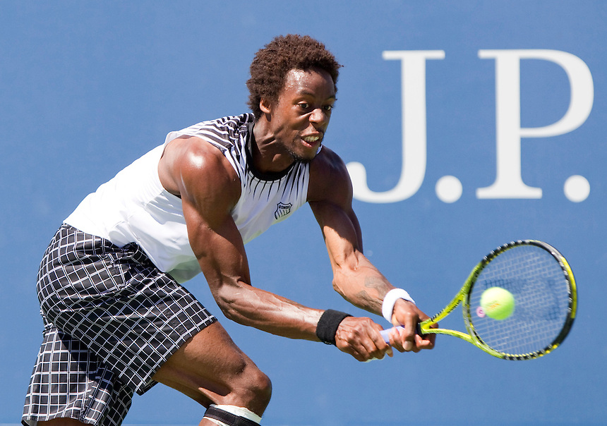 Gael Monfils FRA (17) in action today during his victory over Richard Gasquet FRA in their Men's singles 4th Round match. Gael Monfils FRA (17) def Richard Gasquet FRA 6-4 7-5 7-5..