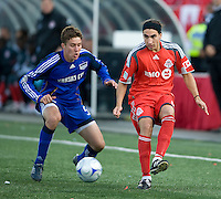26 April 2009:  Kansas City Wizards defender Matt Besler #5 and Toronto FC forward Pablo Vitti #8 in action during an MLS game at BMO Field between Kansas City Wizards and Toronto FC.Toronto FC won 1-0. .