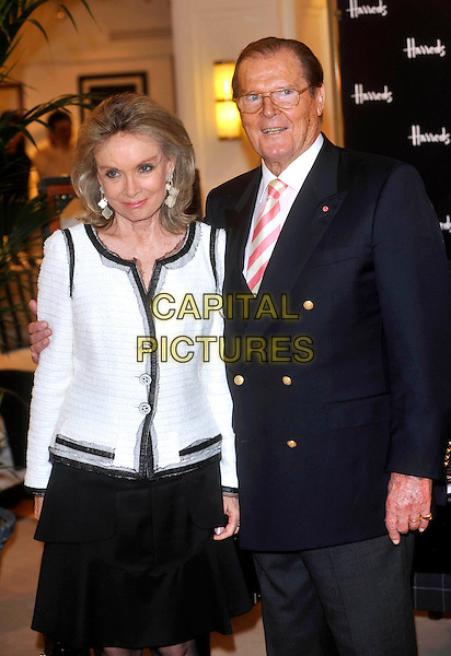 """Kristina """"Kiki"""" Tholstrup & Sir Roger Moore.Photocall for the book signing of 'Bond On Bond', Harrods, Knightsbridge, London, England..11th October 2012.book half length glasses white shirt pinks stripe tie black blue suit jacket white grey gray married husband wife.CAP/ROS.©Steve Ross/Capital Pictures"""