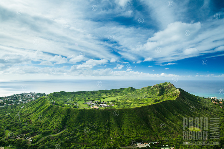An aerial view of a very green Diamond Head Crater on a sunny day, East O'ahu.