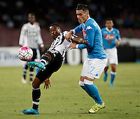 Calcio, Serie A: Napoli vs Juventus. Napoli, stadio San Paolo, 26 settembre 2015. <br /> Juventus&rsquo; Patrice Evra, left, is challenged by Marek Hamsik during the Italian Serie A football match between Napoli and Juventus at Naple's San Paolo stadium, 26 September 2015.<br /> UPDATE IMAGES PRESS/Isabella Bonotto