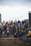 Dundee 0 Greenock Morton 1, 27/08/2011. Dens Park, Scottish League First Division. Home fans watching the closing stages of the action from a vantage point on their way out of the stadium near the end of a Scottish League First Division match at Dens Park stadium against visitors Greenock Morton. The visitors won by one goal to nil watched by a crowd of 4,096. Dundee  stadium was situated on the same street as their city rival Dundee United, whose Tannadice Park ground was situated a few hundred yards away.
