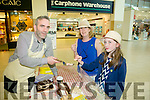 Josephine Trevaskis and Clodagh Trevaskis from Cahermoneen, Tralee with John Harty from Fab Fudge at  Taste of Tralee in  Manor West Retail Park on Saturday