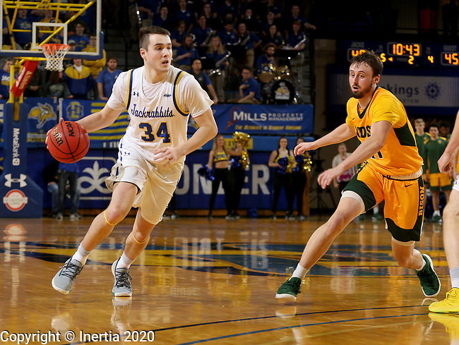 BROOKINGS, SD - JANUARY 22: Alex Arians #34 of the South Dakota State Jackrabbits drives against Jared Samuelson #11 of the North Dakota State Bison at Frost Arena on January 22, 2020 in Brookings, South Dakota. (Photo by Dave Eggen/Inertia)