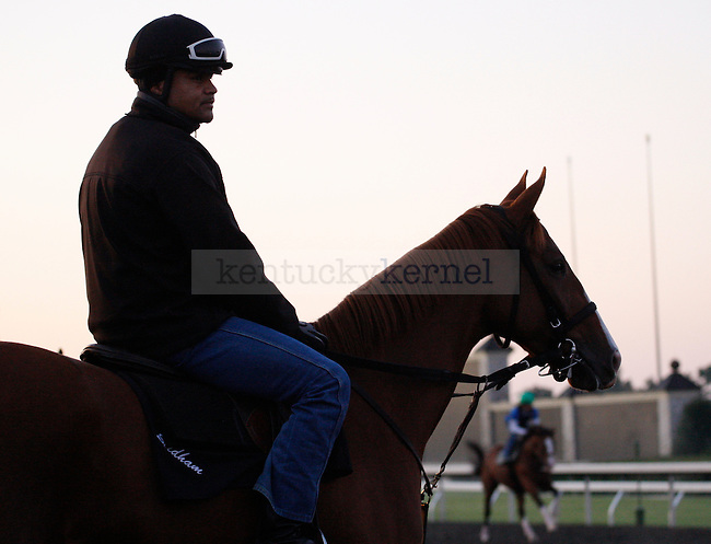 A rider waits to start the morning workout at Keeneland Racetrack in Lexington, Ky., on Wednesday, Oct. 5, 2011. Photo by Tessa Lighty | Staff