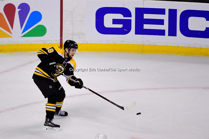 April 21, 2018: Boston Bruins defenseman Matt Grzelcyk (48) passes the puck during game five of the first round of the National Hockey League's Eastern Conference Stanley Cup playoffs between the Toronto Maple Leafs and the Boston Bruins held at TD Garden, in Boston, Mass. Toronto defeats Boston 4-3, Boston leads Toronto 3 games to 2 in the best of 7 series.