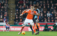 Joe Pigott of Luton Town holds off Sido Jombati of Wycombe Wanderers during the Sky Bet League 2 match between Wycombe Wanderers and Luton Town at Adams Park, High Wycombe, England on 6 February 2016. Photo by Andy Rowland.