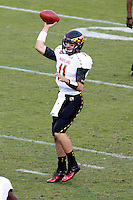 Maryland Terrapins quarterback Perry Hills (11) throws the ballduring the game against Virginia in Charlottesville, Va. Maryland defeated Virginia 27-20.