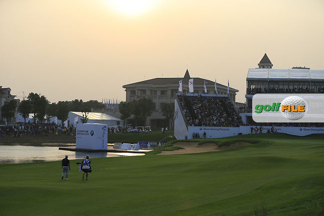 Alexander Levy (FRA) walks to the 18th green during Sunday's Final Round of the 2014 BMW Masters held at Lake Malaren, Shanghai, China. 2nd November 2014.<br /> Picture: Eoin Clarke www.golffile.ie