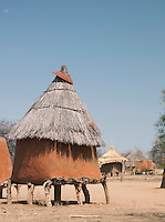 A grain storage hut built on wooden legs to protect from animals. Nyaro village of the Nuba people, Kordofan region, Sudan