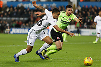 (L-R) Kyle Naughton of Swansea City runs past Enda Stevens of Sheffield United during the Sky Bet Championship match between Swansea City and Sheffield United at the Liberty Stadium, Swansea, Wales, UK. Saturday 19 January 2019