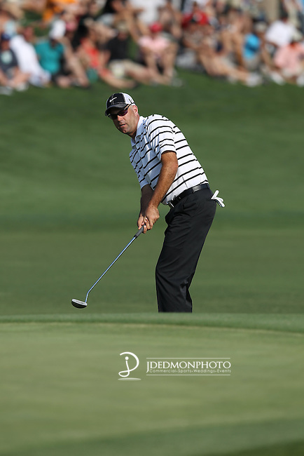 May 8,2011 - Stewart Cink putts up to the green on 15.  Lucas Glover wins the tournament in sudden death over Jonathan Byrd at Quail Hollow Country Club,Charlotte,NC.