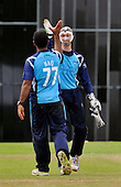 CB40 Cricket - Scottish Saltires V Northampton Steelbacks at Grange CC - Edinburgh - high fives for Saltire Majid Haq and keeper Gregor Maiden whose contributions helped put the Saltires on course for victory - Picture by Donald MacLeod - 17.07.11 - 07702 319 738 - www.donald-macleod.com