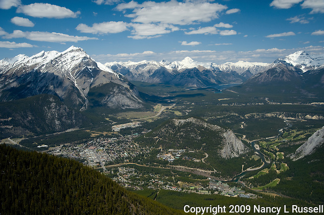 The town of Banff and sourrounding mountains as seen from the gondola traveling up to Mt Rundle