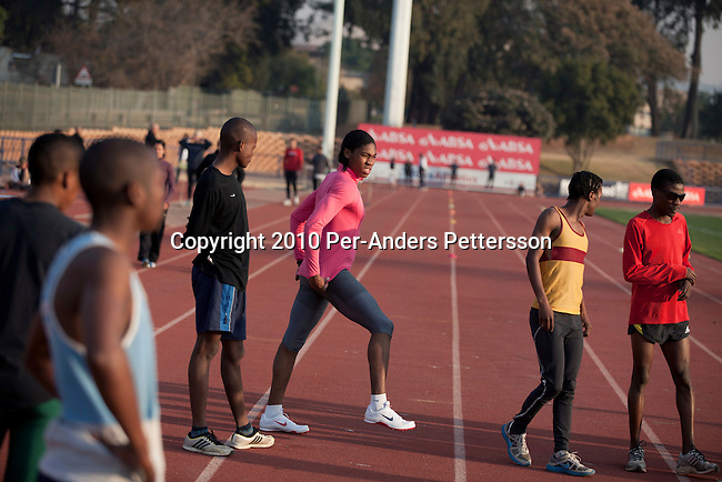 PRETORIA, SOUTH AFRICA - AUGUST 10: Caster Semenya (c), age 19, trains at the High Performance Center at the university of Pretoria on August 10, 2010 in Pretoria, South Africa. Caster Semenya won the 800 meters world championship gold medal in Berlin in 2009 was recently cleared to run after her career was held back due to gender testing. She grew up in a rural village in Limpopo, northern South Africa, and she started running only a few years ago, and quickly appeared from nowhere to the world stage. After being banned for almost a year she was cleared by the IAAF and cleared to compete in July 2010. (Photo by Per-Anders Pettersson/Getty Images)