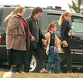 Buckhannon, WVa - January 8, 2006 -- Unidentified women leave the funeral of Jesse L. Jones, 44, following the service in Buckhannon, West Virginia on January 8, 2006.   Mr. Jones perished in the Sago Mine explosion on January 2, 2006..Credit: Ron Sachs / CNP
