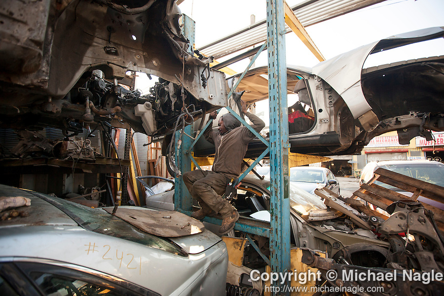 QUEENS, NY -- OCTOBER 22, 2013:  Kareem Williams works at ACDC Scrap Metal Inc. in Willets Point on October 22, 2013 in Queens.  Photographer: Michael Nagle for The New York Times