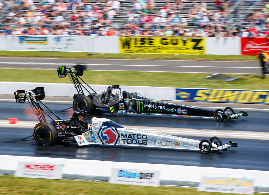 Jun 11, 2017; Englishtown , NJ, USA; NHRA top fuel driver Antron Brown (near) races alongside Brittany Force during the Summernationals at Old Bridge Township Raceway Park. Mandatory Credit: Mark J. Rebilas-USA TODAY Sports