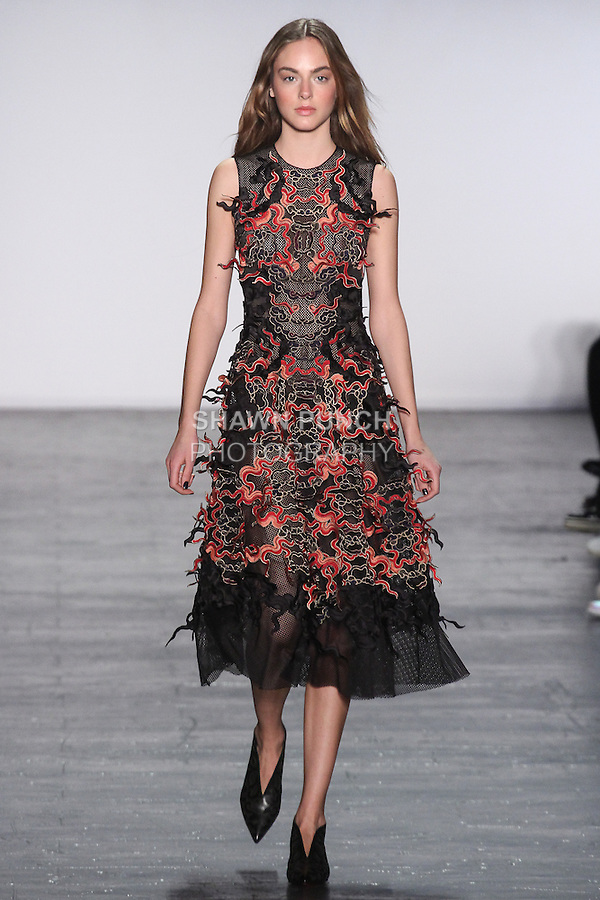 """Model Alma walks runway in a mesh sleeveless fire dress with fire cloud embroidery applique, from the Vivienne Tam Fall Winter 2016 """"Cultural Dreamland The New Silk Road"""" collection, presented at NYFW: The Shows Fall 2016, during New York Fashion Week Fall 2016."""