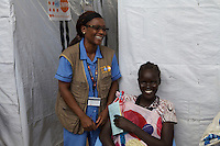 UNFPA South Sudan supports human capacity building in the health sector. UNV attending women at the reproductive health clinic at POC1 in Juba where currently 15.000 IDPs live.