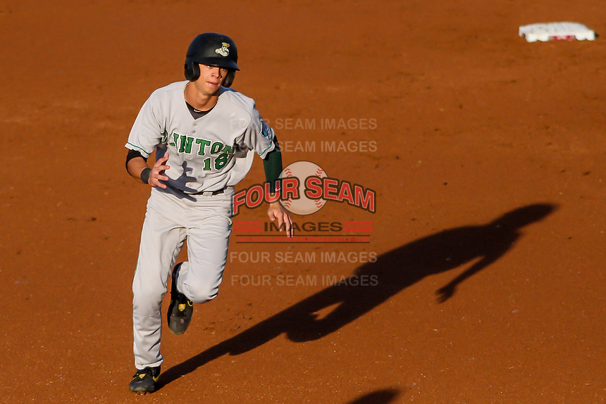 Clinton LumberKings Connor Scott (18) races to third base during a Midwest League game against the Wisconsin Timber Rattlers on June 20, 2019 at Fox Cities Stadium in Appleton, Wisconsin. Wisconsin defeated Clinton 5-2. (Brad Krause/Four Seam Images)