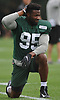 Josh Martin #95 stretches during New York Jets Training Camp at the Atlantic Health Jets Training Center in Florham Park, NJ on Monday, Aug. 14, 2017.