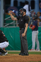 Umpire Tyler Witte calls a strike during a NY-Penn League game between the State College Spikes and Batavia Muckdogs on July 1, 2019 at Dwyer Stadium in Batavia, New York.  Batavia defeated State College 5-4.  (Mike Janes/Four Seam Images)