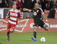 D.C. United forward Maicon Santos (29) goes against FC. Dallas midfielder Daniel Hernadez (2) D.C. United defeated FC Dallas 4-1 at RFK Stadium, Friday March 30, 2012.