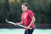STANFORD CA - September 23, 2011:  Assistant Coach Patrick Cota helps the team warm up before the Stanford vs Cal at vs Lehigh field hockey game at the Varsity Field Hockey Turf Friday night at Stanford.<br /> <br /> The Cardinal team defeated the Golden Bears 3-2.