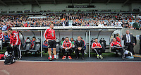 Pictured: The Swansea bench, Kristian O'Leary, Josep Pep Clotet and Garry Monk Sunday 30 August 2015<br />