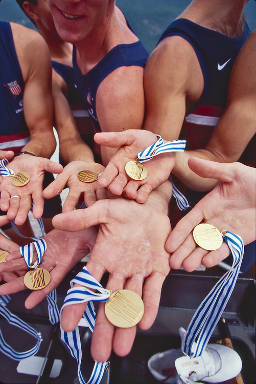 US rowing team Men's, eight, eight-oared racing shell, hands shows gold medals and calluses from a season of competition, world champions, FISA World Rowing Championships, Lac Aiguebelette,  France, Europe, 1997,.