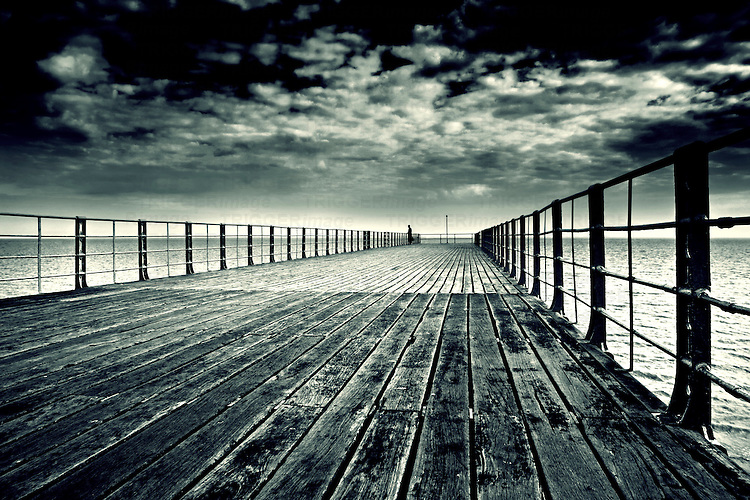 Wide angle photo of Bognor Resgis pier with lonely single person