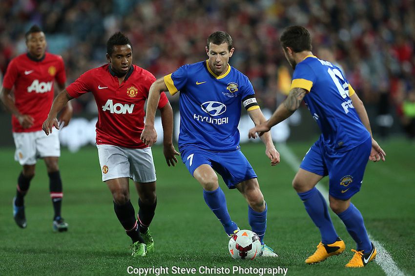 A-League All Stars captain Brett Emerton on the attack against Manchester United at Stadium Australia, Sydney, Australia. Saturday, 20th July, 2013. (Photo: Steve Christo)