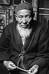 Mullah Choquev Abdikarim poses for his portrait in the Murghab province of Tajikistan