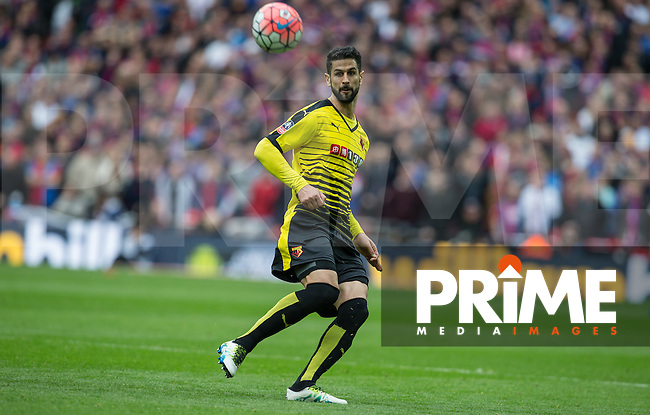Miguel Angel Britos of Watford hits the ball upfield during the FA Cup Semi Final match between Crystal Palace and Watford at Wembley Stadium, London, England on 24 April 2016. Photo by Andy Rowland.