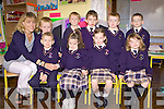 Miss Maire Collins lends a helping hand to her new Juinor Infants who started on Tuesday at Scoil Mhaire, Knocknagashal, Co. Kerry (NO NAMES POLICY)